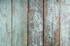破旧的绿松石老被绘的木纹理 库存照片