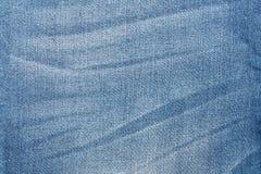 破旧的蓝色牛仔裤纹理 牛仔布织品背景 免版税库存图片