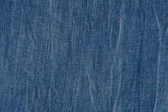 破旧的蓝色牛仔裤 库存图片