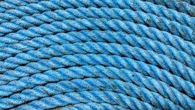 破旧的蓝色绳索 库存照片