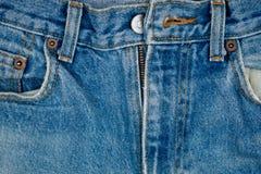 破旧的裤子牛仔裤特写镜头细节  库存照片