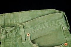 破旧的裤子牛仔裤特写镜头细节  库存图片