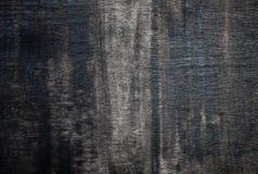 破旧的黑色被绘的胶合板。 免版税库存照片