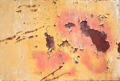 破裂的橙色油漆 库存照片