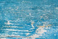 破裂的老绿松石和蓝色油漆在木背景 库存图片