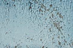 破裂的老绿松石和蓝色油漆在木背景 库存照片