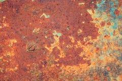 破裂的被风化的老蓝色生锈的油漆背景 库存照片