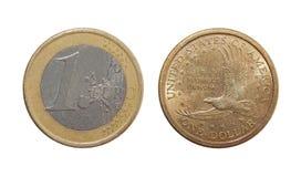 硬币一欧元,一美元 免版税图库摄影