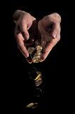 硬币下落金子 免版税库存照片