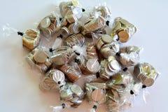硬币包裹与塑料 免版税库存照片