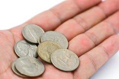 硬币在手中 免版税图库摄影
