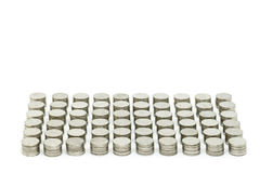 硬币堆积每10枚硬币在白色背景隔绝的金黄集合 选择聚焦和没指定的国家 库存照片