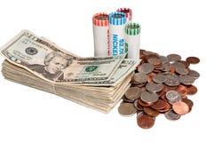硬币堆美国货币和劳斯  图库摄影