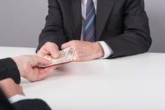 硬币查出的货币汇款栈调用白色 免版税库存图片