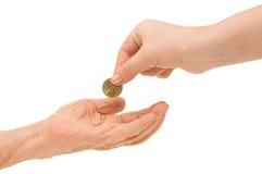 硬币现有量老年轻人 免版税库存图片