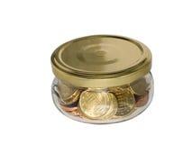 硬币玻璃瓶子货币 库存图片