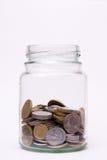 硬币瓶子 免版税库存照片