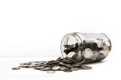硬币的罐 免版税图库摄影
