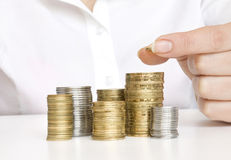 硬币硬币现有量放置的栈 免版税库存图片