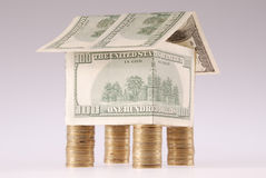 硬币费用美元房子 免版税库存图片