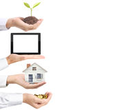 硬币,房子,片剂,树,对金钱在手中 免版税库存图片