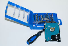 硬盘和精确度螺丝刀-数据补救 免版税库存照片