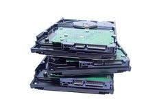 硬盘堆在被隔绝的白色背景的techno背景 库存图片