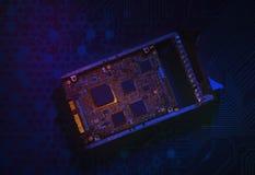 硬盘驱动器在黑暗的背景的电路板 图库摄影