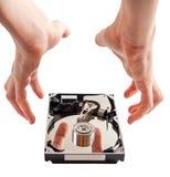 硬盘细节和手 免版税库存图片