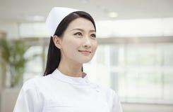 确信和美丽的护士,中国画象  免版税库存照片