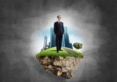 确信的上司和现代城市作为eco的概念绿化建筑 图库摄影