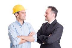 确信的工程师和面对面的商人 免版税库存照片
