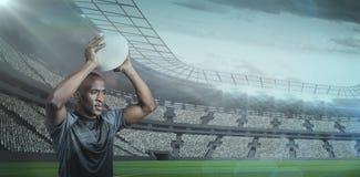 确信的运动员投掷的橄榄球球的综合图象3D 库存图片