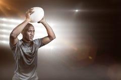 确信的运动员投掷的橄榄球球3D的综合图象 免版税库存图片