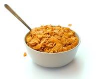 碗与匙子的玉米片谷物 免版税库存图片