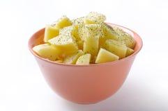 碗求土豆的立方 免版税图库摄影