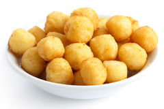 碗油煎的小土豆球 库存图片