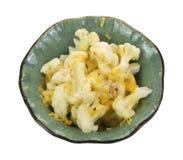 碗煮熟的花椰菜干酪 库存图片