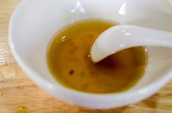 碗以后吃了中国点心,寒冷与长的煮沸的银杏树 图库摄影