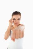 碰撞与她的拳头的女性武术战斗机 免版税库存图片