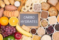 碳水化合物食物来源,在桌上的顶视图 免版税库存图片