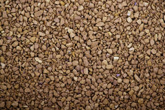 碾碎的咖啡粒子变苍白褐色 免版税图库摄影