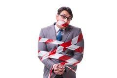 磁带栓的商人隔绝在白色 免版税库存照片