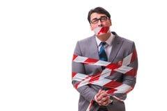 磁带栓的商人隔绝在白色 免版税库存图片