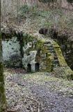 磨房废墟雕刻了入岩石 库存照片