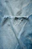 磨损的牛仔裤 免版税库存图片