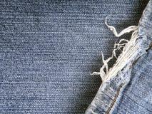 磨损的蓝色牛仔裤 免版税库存照片