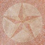 磨石子地地板表面用星装饰 免版税图库摄影