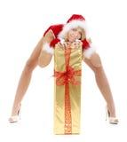 礼品圣诞老人性感的妇女 免版税库存照片