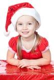 礼品女孩帽子一点圣诞老人白色 库存照片